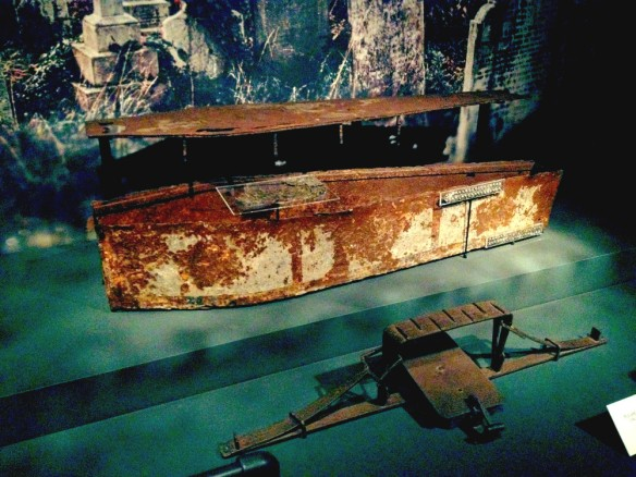 The remains of an iron coffin and, in front of it, a trap. These were used to deter body snatchers from stealing the bodies of the wealthy who could afford such deterrents.